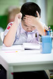 Asian boy be bored doing his homework Royalty Free Stock Images