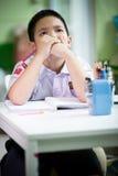Asian boy be bored doing his homework Stock Photos