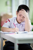 Asian boy be bored doing his homework Stock Images