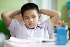 Asian boy be bored doing his homework. At home Royalty Free Stock Images