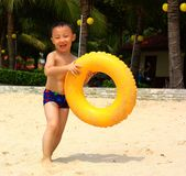 Asian boy at beach Royalty Free Stock Photo