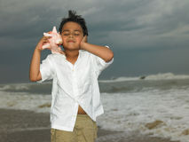 Asian boy in the beach Stock Photo