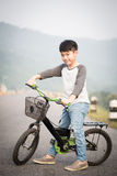 Asian Boy on bicycle Royalty Free Stock Images