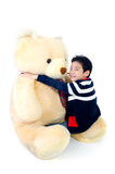 Asian boy with big bear doll . Royalty Free Stock Photography