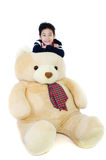 Asian boy with big bear doll Stock Photos