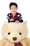 Asian boy with big bear doll Royalty Free Stock Photography