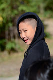 Asian boy in a black hooded sweat shirt Stock Photos