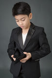Asian boy in black suit look at his empty wallet Stock Photo