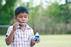 Asian boy blowing bubbles Stock Image