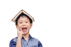 Asian boy with book on head thinking Royalty Free Stock Photos