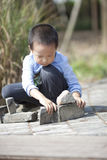 Asian boy building house by brick  blocks Stock Images