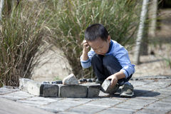 Asian boy building house by brick  blocks Royalty Free Stock Photo