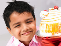 Asian boy with cake Stock Photo