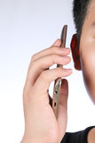 Asian boy calling on the smartphone royalty free stock image
