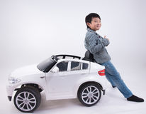 Asian boy car toy Stock Photography