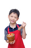 Asian boy chef with papaya salad Royalty Free Stock Images