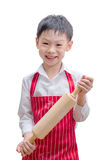 Asian boy chef showing rolling pin Stock Image