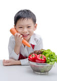 Asian boy chef and vegetable Royalty Free Stock Images