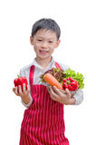 Asian boy chef and vegetable Royalty Free Stock Image