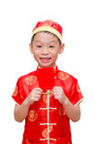 Asian boy with Chinese traditional dress with ang pow Stock Image