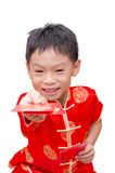 Asian boy with Chinese traditional dress giving ang pow Stock Image