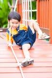 Asian boy climbing the rope Stock Image