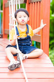 Asian boy climbing the rope Royalty Free Stock Images