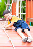 Asian boy climbing the rope Stock Photography
