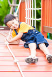 Asian boy climbing the rope Stock Images