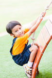 Asian boy climbing the rope Royalty Free Stock Photography