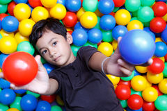 Asian boy and colorful small ball Royalty Free Stock Image
