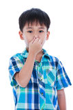 Asian boy covering his nose. Isolated on white background. Royalty Free Stock Photography
