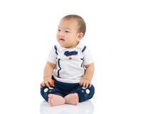 Asian boy. Cute asian boy sitting on the floor Royalty Free Stock Image