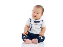 Asian boy. Cute asian boy sitting on the floor Stock Photos