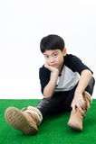 Asian boy  in a depressed mood . Stock Photos