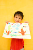 Asian Boy Displaying his Artwork Royalty Free Stock Photos