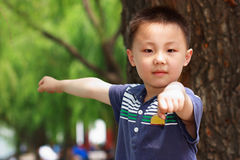 Asian boy is doing exercises Royalty Free Stock Images