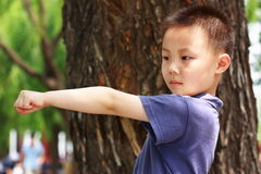 Asian boy is doing exercises Stock Image