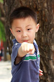 Asian boy is doing exercises Stock Photography