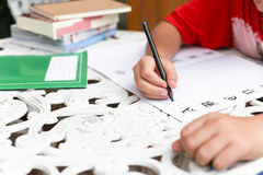 Asian boy doing his homework Stock Images