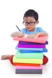 Asian boy doing homework Stock Image