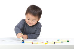 Asian boy drawing with crayon Royalty Free Stock Images