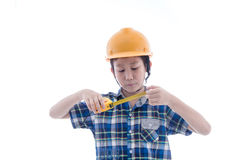Asian boy dressed like worker holding measuring tape Stock Image