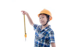 Asian boy dressed like worker holding measuring tape Royalty Free Stock Images