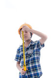 Asian boy dressed like worker holding measuring tape Stock Photos