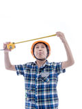 Asian boy dressed like worker holding measuring tape Royalty Free Stock Photography