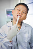 Asian boy dresses up and plays a doctor Stock Photography