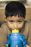 Asian boy drinking. Close up photo of cute asian boy drinking from a bottle Stock Image