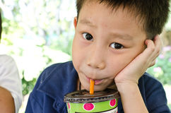 Asian boy drinking water Royalty Free Stock Photo