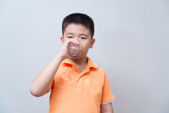 Asian boy drinking water from glass Stock Photography